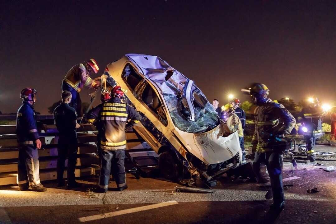 firemen-trying-release-man-from-fatal-car-accident